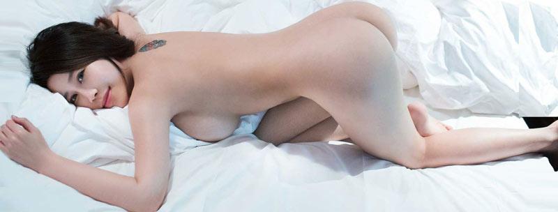 Nude escort model of new york city in bed